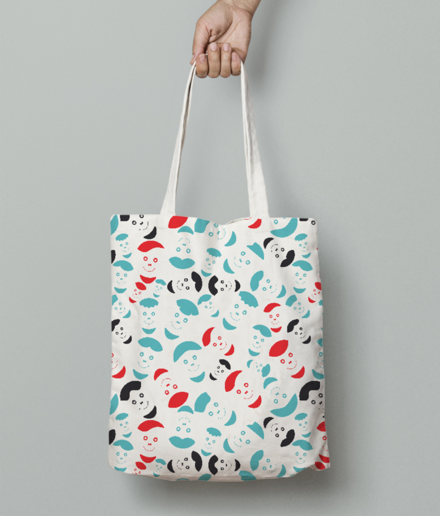 Red smiley faces tote bag front