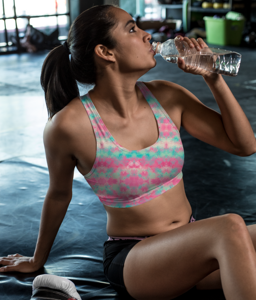 Pink clouds sports bra front