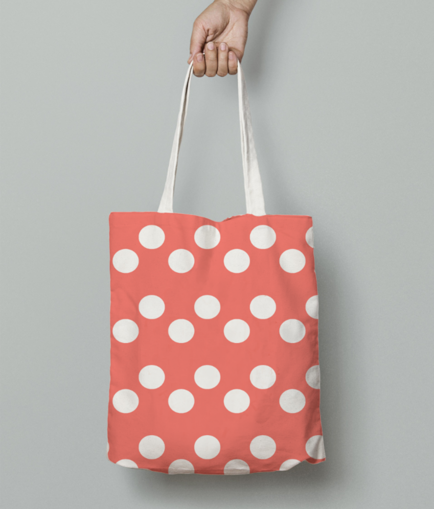 White dots living coral pattern tote bag front