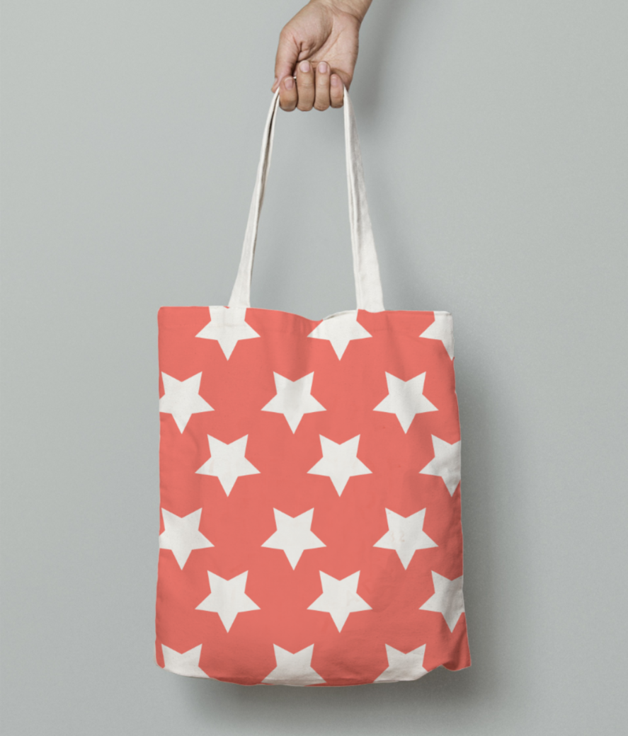 White stars living coral pattern tote bag front