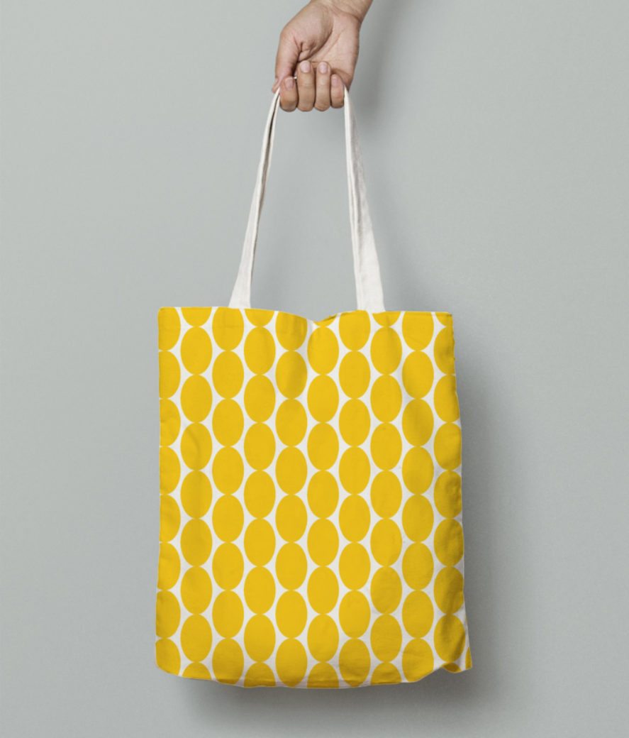 Yellow egg shape pattern tote bag front