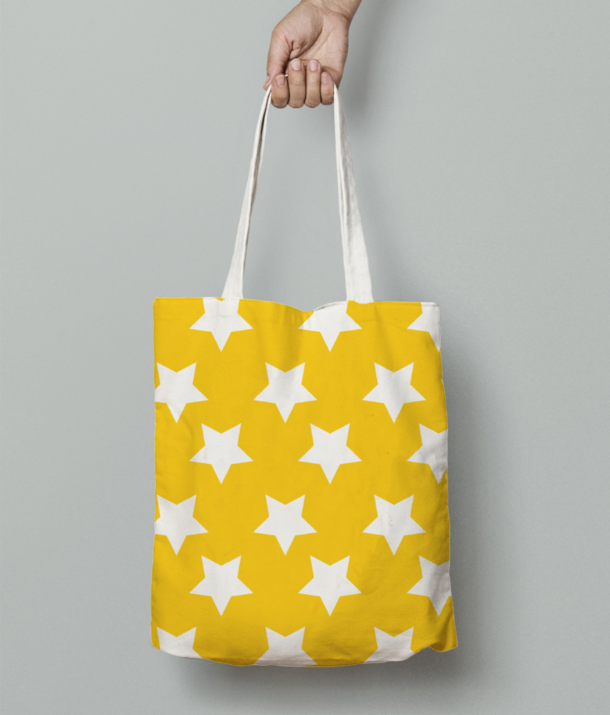 Yellow white stars pattern tote bag front